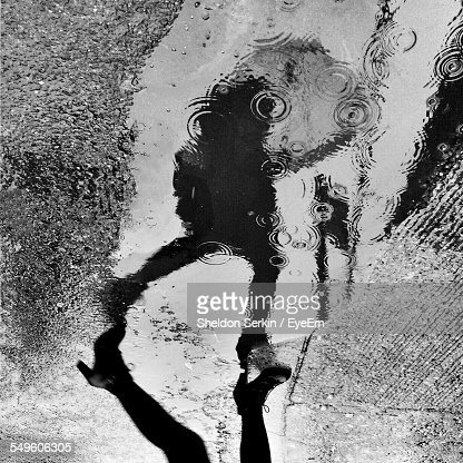 Reflection Of Person In Puddle