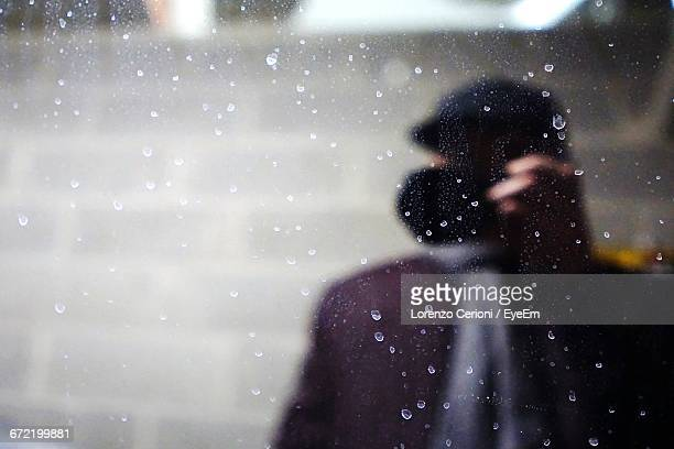 Reflection Of Person On Wet Glass