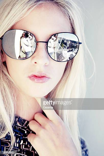 Reflection of Photographer in Young Woman's Sunglasses