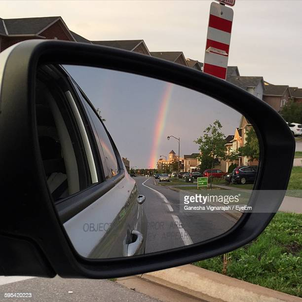 Reflection Of Rainbow On Car Side-View Mirror
