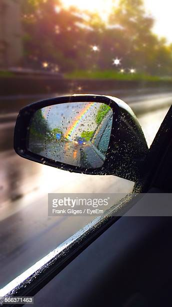 Reflection Of Rainbow On Rear View Mirror