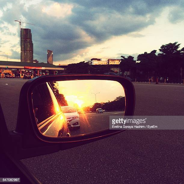 Reflection Of Road On Side-View Mirror During Sunset