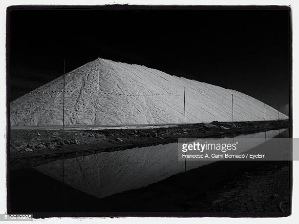 Reflection of salt pan in calm water