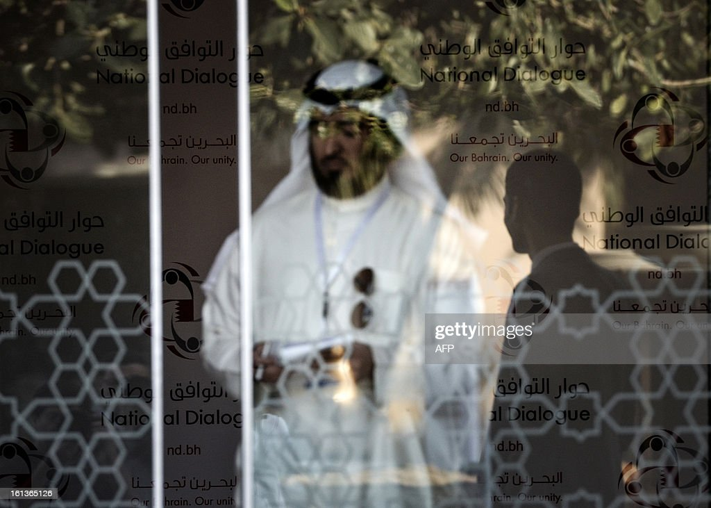 Reflection of Security man is seen on glass door of al-Areen Palace Hotel in Zallaq, South of Manama, where the national dialogue is being held on February 10, 2013. Bahrain's key political players began a new round of talks on Sunday to try to resolve the kingdom's two-year crisis, after opposition groups made a last-minute decision to join a national dialogue.