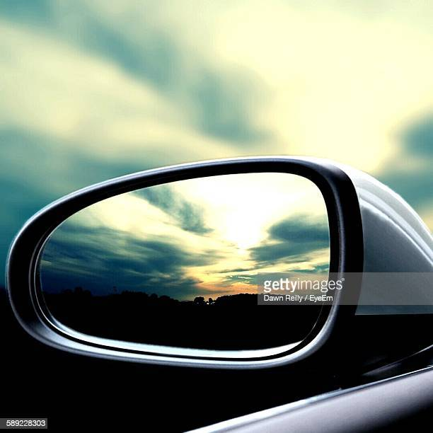 Reflection Of Silhouette Landscape Seen On Rear-View Mirror
