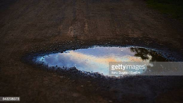 Reflection Of Sky In Puddle