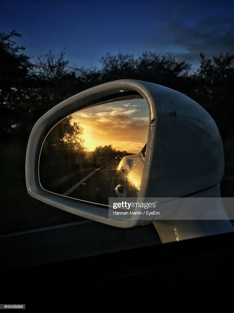 Reflection of sky on sideview mirror stock photo getty for Mirror reflection