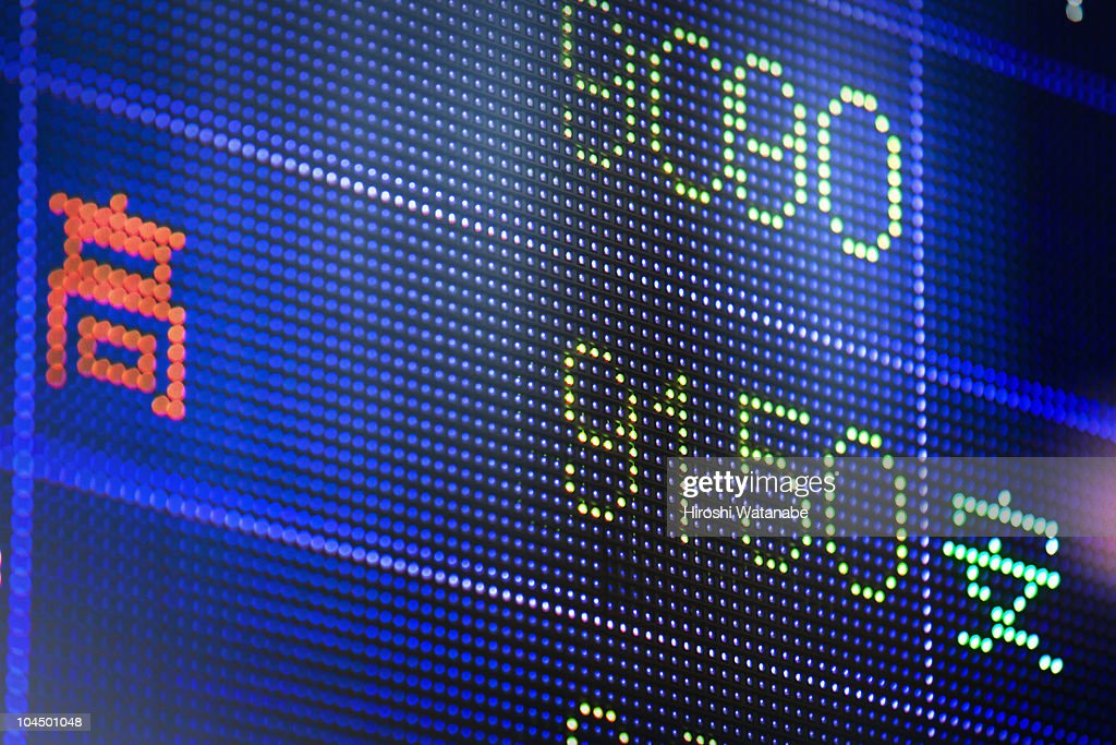 Reflection of stock readings in window : Stock Photo