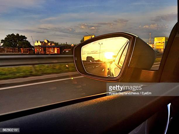 Reflection Of Street On Side-View Mirror