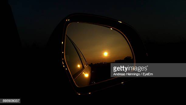 Reflection Of Sun Seen On Side-View Mirror