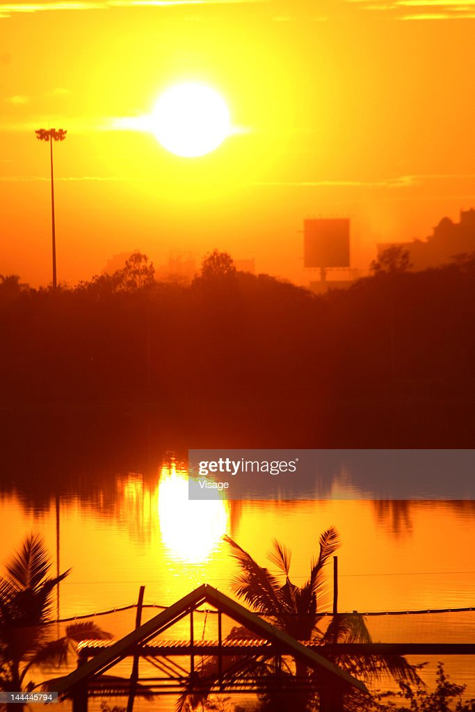 Reflection of sunset over a lake : Stock Photo