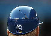 A reflection of the CN Tower in the helmet of first base coach Rusty Kuntz of the Kansas City Royals during MLB game action against the Toronto Blue...
