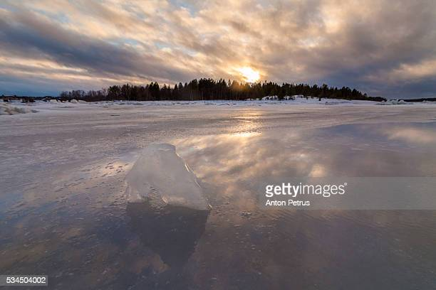 Reflection of the sunset on the ice