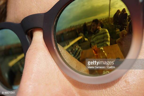 Reflection Of Tourists In Sunglasses