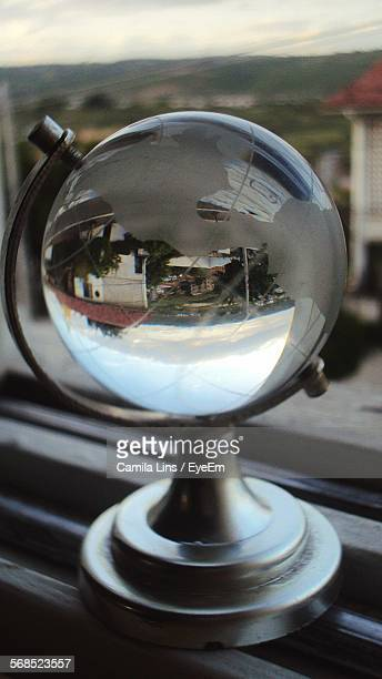 Reflection Of Town In Globe