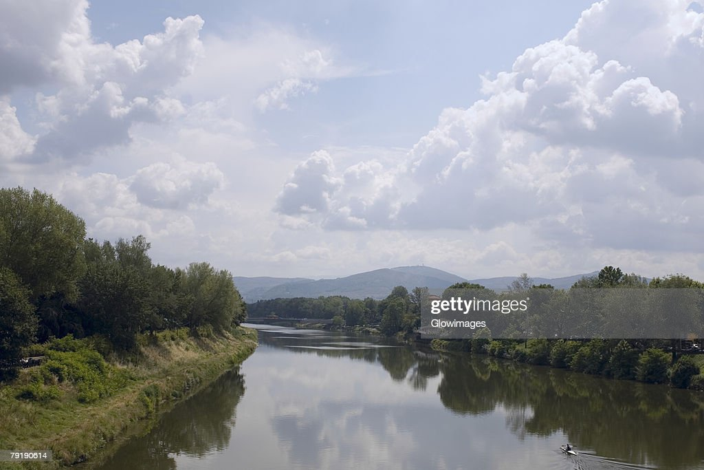 Reflection of trees in water, Arno River, Florence, Italy : Foto de stock
