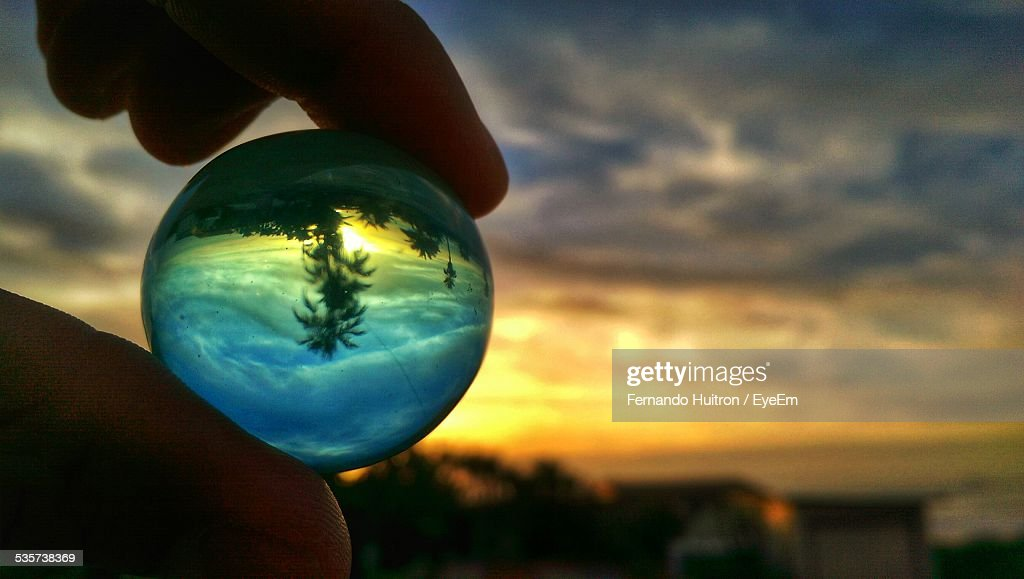 Reflection Of Trees On Crystal Ball At Dusk
