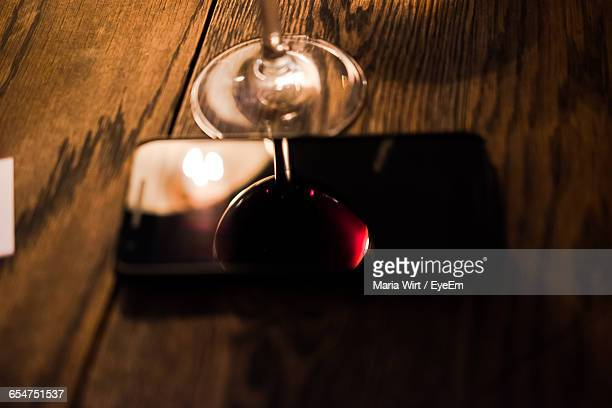 Reflection Of Wineglass On Mobile Phone