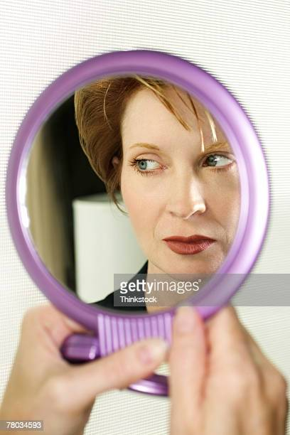 Reflection of woman in round mirror