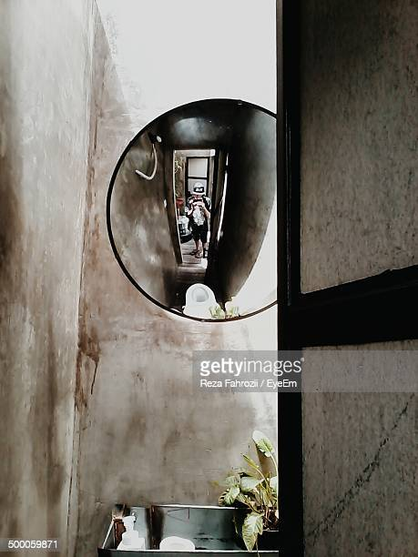 Reflection of woman in the bathroom mirror