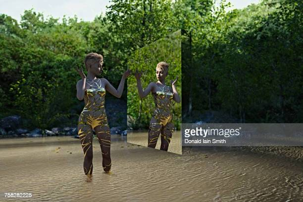 Reflection of woman in virtual mirror standing in river