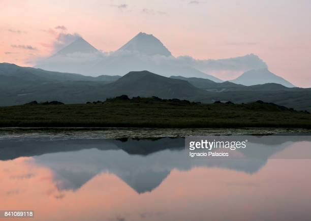 Reflection on lake at sunrise, Tolbachik volcanic complex, Kamchatka