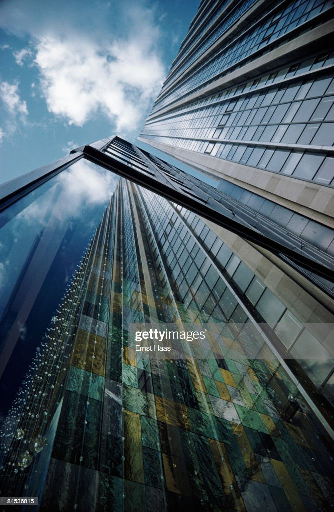 Reflections and coloured glass panels in the windows of the Time Life building at 1271 Avenue of the Americas New York December 1961