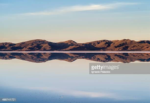 Reflections in El Salar de Uyuni at sunset
