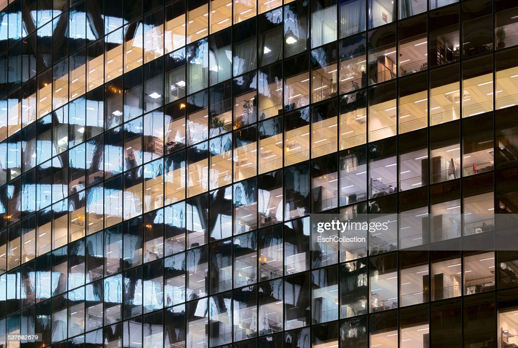 Reflections in glass office facade at dusk : Stock Photo
