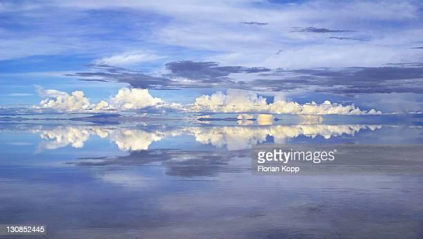 Reflections in the flooded salt desert Salar de Uyuni, Bolivia. Sunset