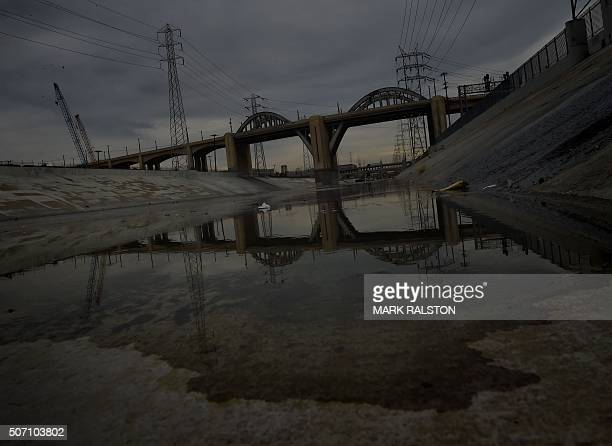 Reflections in the Los Angeles River after the closure of the iconic 6th Street Bridge that connects downtown Los Angeles with its eastern disticts...