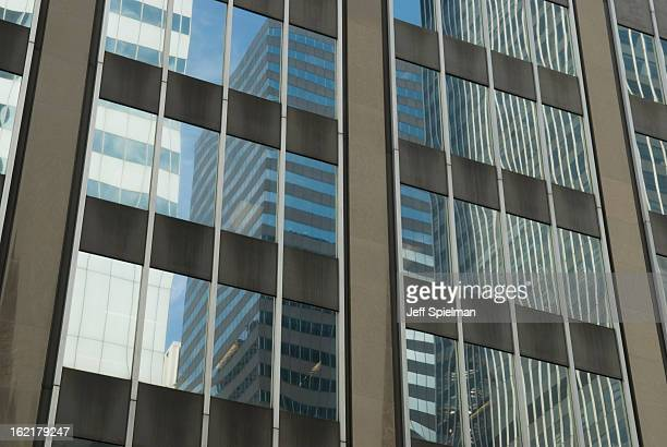 Reflections in the windows of an office block