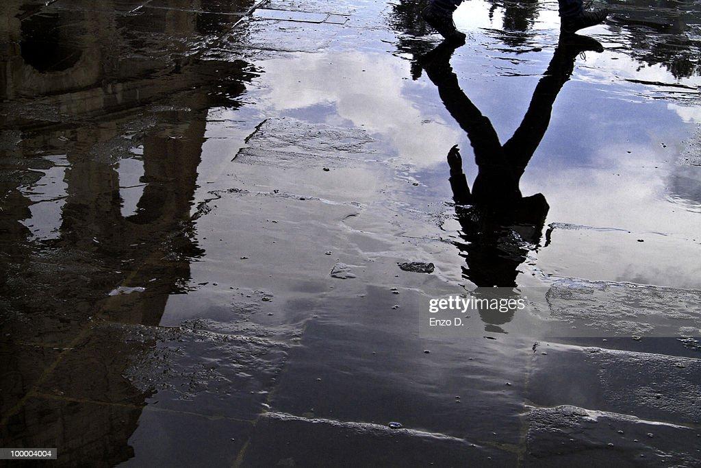 Reflections near the Coliseum : Stock Photo