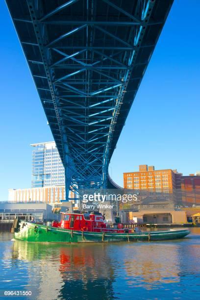 Reflections of barge under bridge Cleveland