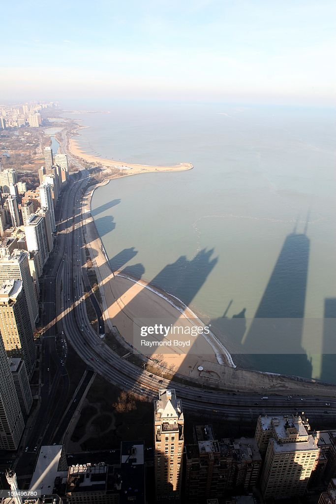 Reflections of high rise buildings and The John Hancock Center, along north Lakeshore Drive, as photographed from the observatory deck of The John Hancock Center, in Chicago, Illinois on JANUARY