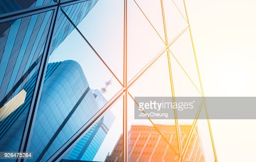 Reflections of modern commercial buildings on glasses with sunlight : Stock Photo