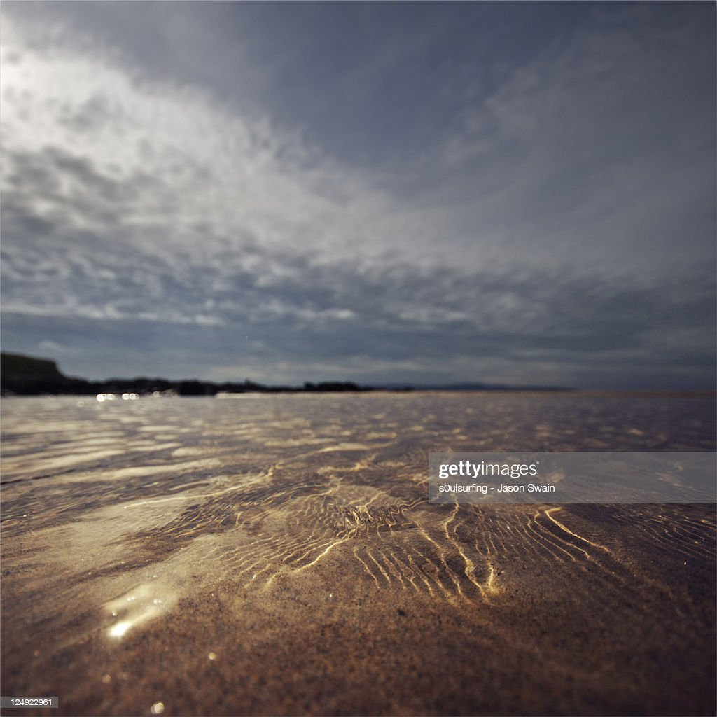 Reflections on Gwithian sands : Stock Photo