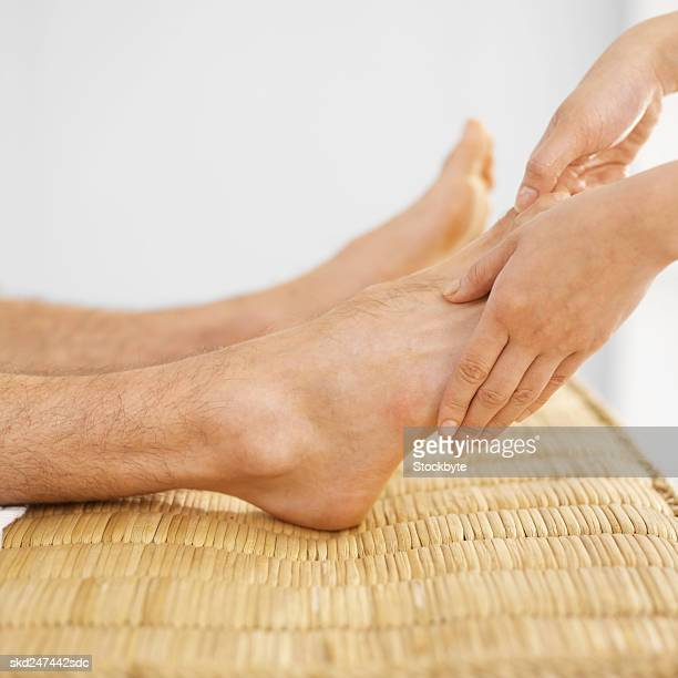 Reflexologist giving a massage