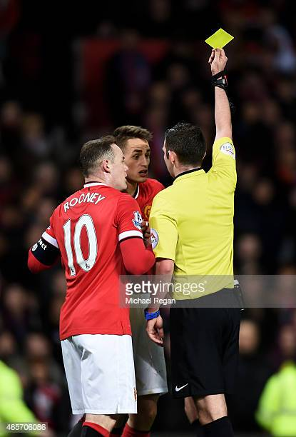 Refree Michael Oliver shows a yellow card to Adnan Januzaj of Manchester United for simulation during the FA Cup Quarter Final match between...