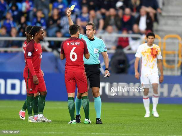 Refree Tobias Stieler gives yellow card to Portugal's midfielder Ruben Neves during the UEFA U21 European Championship Group B football match Spain v...