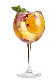 Refreshing cocktail with ice fruit juice and cranberries on a white background, isolated