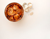 Refreshing glass of cola with ice