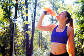 Refreshment after physical activity efforts. Sport, Relaxation Exercise, Exercising, Women, Healthy Lifestyle, health, healthy, drink, energy, bottle, fitness, sport, fresh