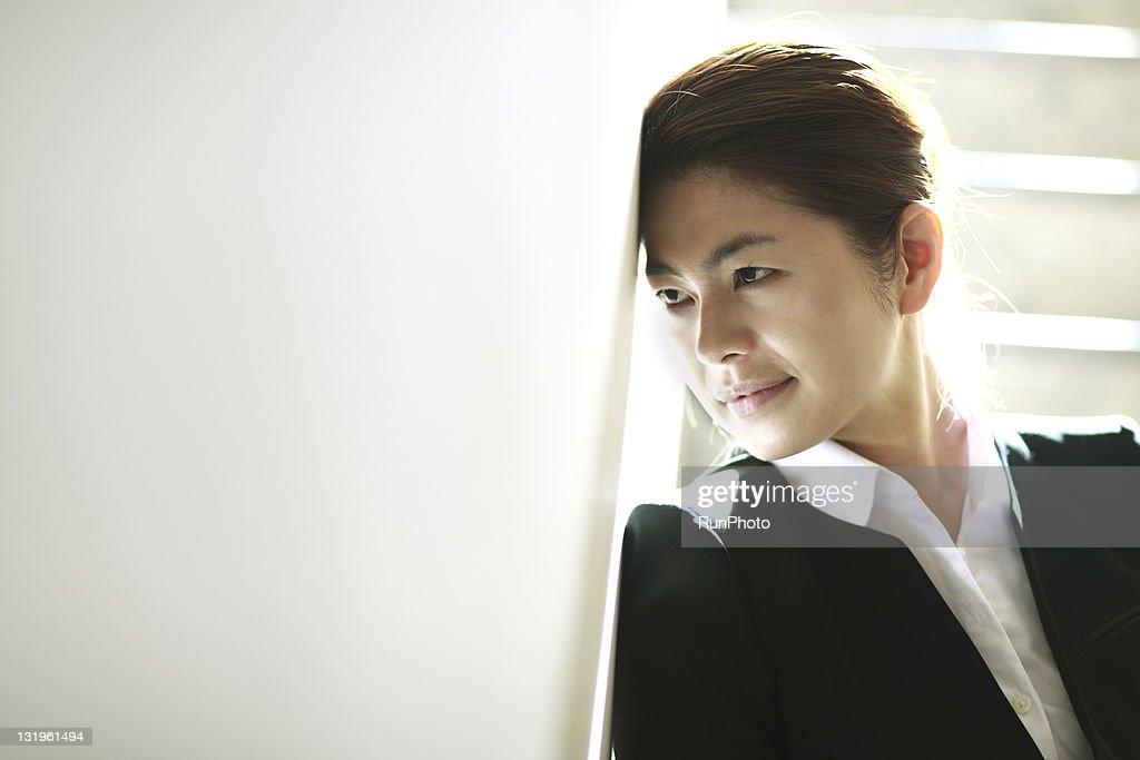 Refreshmentbusinesswoman resting  on stairs : Stock Photo