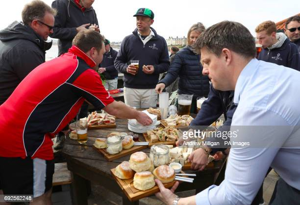 Refreshments are handed out at the beach cricket match in Elie between the Ship Inn cricket team in Elie Fife and Eccentric Flamingos CC The Ship Inn...