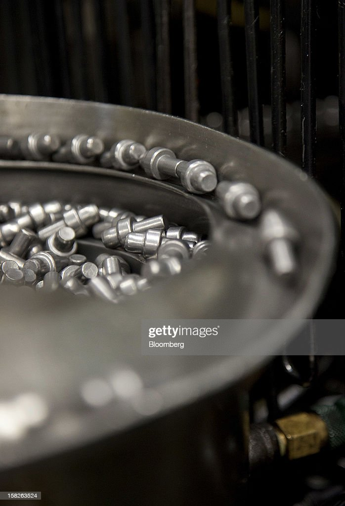 Refridgerator hinge pins move along the production line at the E.J. Ajax & Sons metalforming company in Minneapolis, Minnesota, U.S., on Thursday, Dec. 6, 2012. The U.S. Federal Reserve is scheduled to release industrial production data on Dec. 14. Photographer: Ariana Lindquist/Bloomberg via Getty Images