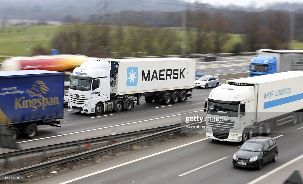 A refrigerated Maersk unit, operated by A.P. Moller-Maersk A/S, is moved by truck along the northern section of the M25 motorway near London, U.K., on Wednesday, March 27, 2013. The U.K. government will increase spending on infrastructure projects, including road construction, by an annual 3 billion pounds ($4.6 billion) from 2015 as Chancellor George Osborne seeks to boost economic growth. Photographer: Chris Ratcliffe/Bloomberg via Getty Images