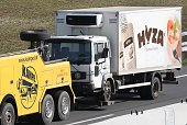 A refrigerated truck is towed along a highway near Neusiedl am See Austria on August 27 2015 The bodies of between 20 and 50 migrants have been found...
