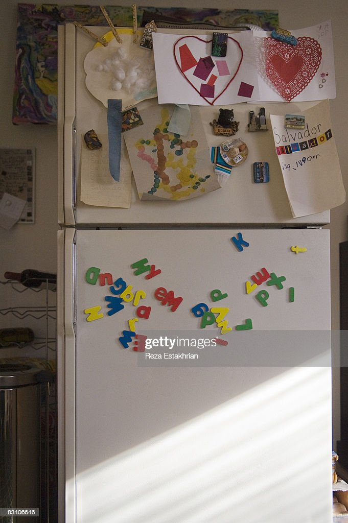 Refrigerator door with child's school art projects : Stock Photo