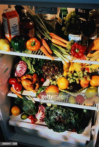 Refrigerator full of fruit and vegetables, close-up